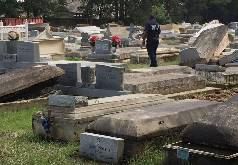 Willie Brooks III walks through Plainview Cemetery