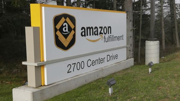 A sign for the Amazon.com fulfillment center in DuPont, Wash., is shown Monday, Nov. 30, 2015. (AP Photo/Ted S. Warren)