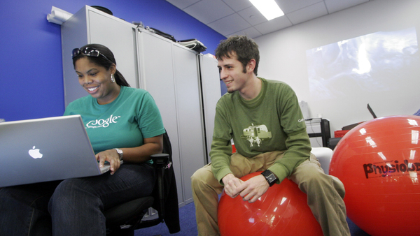 Google employees Erica Baker, left, and Raiford Storey work in the company's New York office space. The Mountain View, Calif.-based company has 8,000 employees worldwide, with 500 in its New York facility. The inflatable red balls are part of the playful atmosphere of the office. (Photo: AP/Mark Lennihan)