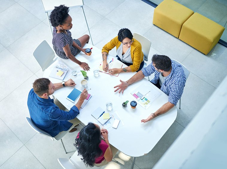 Aerial view of people meeting around a table