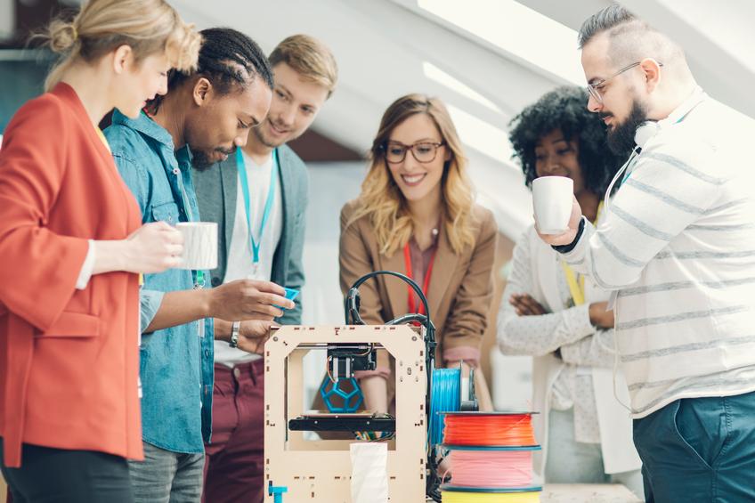 Team standing around an invention