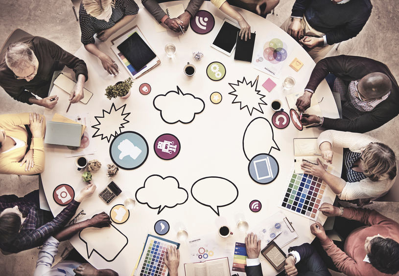 Team-working-creatively-overhead-view