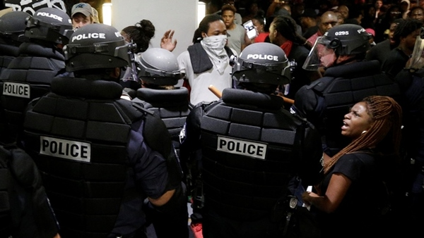 Demonstrators are confronted by police at a hotel during a protest Wednesday of the fatal police shooting of Keith Lamont Scott in Charlotte, N.C. on Tuesday. (Photo: Chuck Burton/AP Photo)