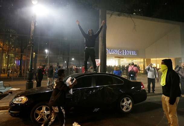 Protester on top of car Charlotte NC 092212016