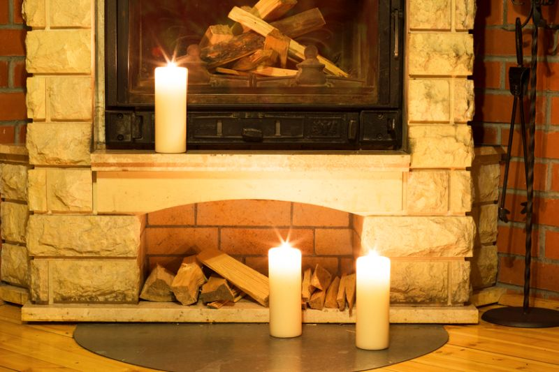 candles burning in home near fireplace