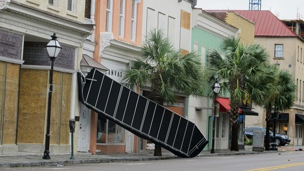 A wrecked awning from a store in the business district in Charleston, S.C., is seen on Oct. 8, 2016, after Hurricane Matthew passed through. (Photo: AP/Bruce Smith)