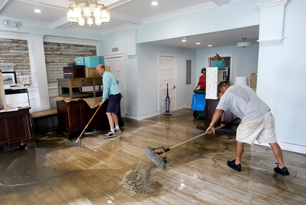 Men cleaning office after flood