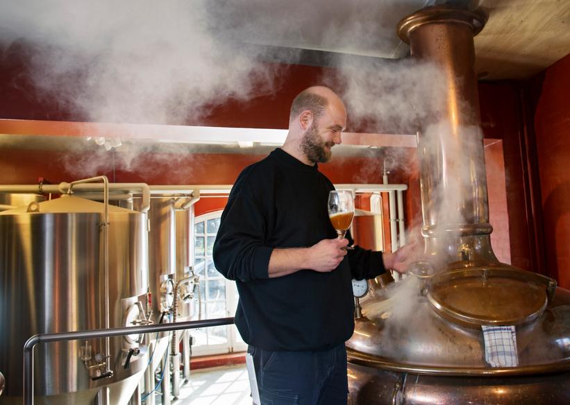 Brewer sampling beer