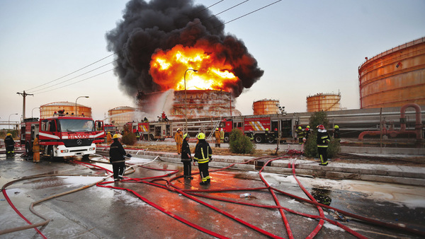 In this photo released by the semiofficial Iranian Isna News Agency, and taken on July 4, 2016, firefighters try to extinguish a blaze at the Bou Ali Sina Petrochemical Complex at the Imam Khomeini port, southwestern Iran. (Borna Ghasemi/ISNA via AP)