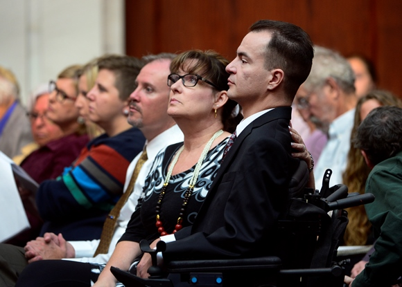 Paraplegic man in wheelchair in courtroom