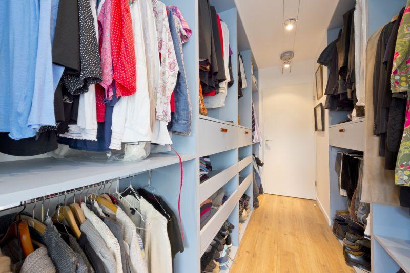 clothes in a walkin closet