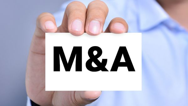 man holding M&A sign