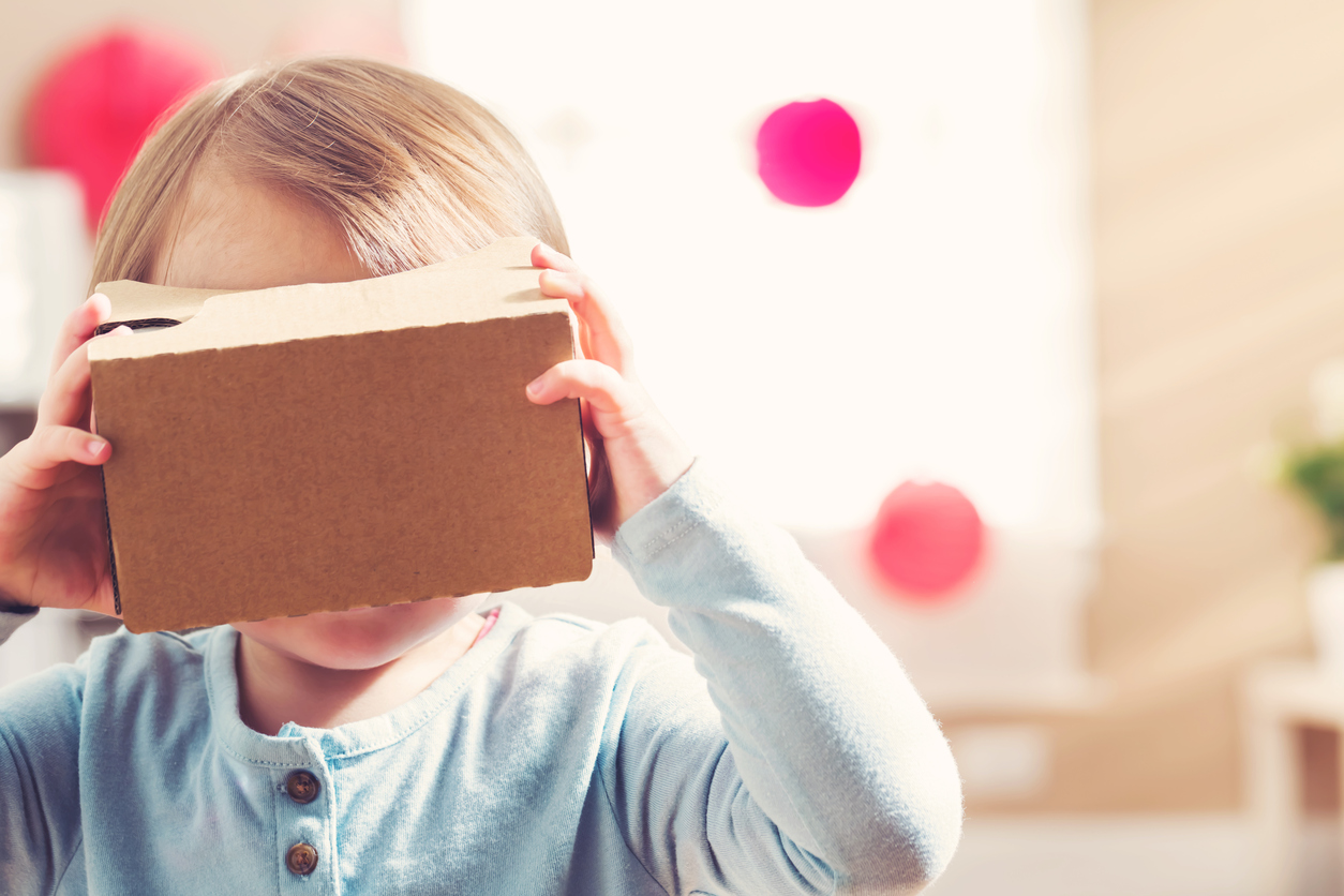 Child using virtual reality goggles