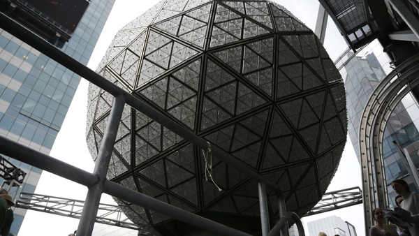 The New Year's Eve ball rests at the top of a building overlooking Times Square, in New York, Tuesday, Dec. 27, 2016. The dropping of the ball has been a tradition in Times Square since 1907. (AP Photo/Seth Wenig)