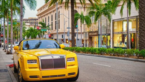 A yellow colored Rolls-Royce Phantom convertible parked on Rodeo Drive with luxury stores in the background in Beverly Hills, California. The 2015 U.S. median household income was $55,775, but not on Rodeo Drive. (Photo: iStock)