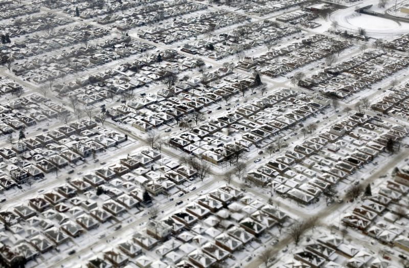 aerial view of homes covered in snow and ice in Chicago