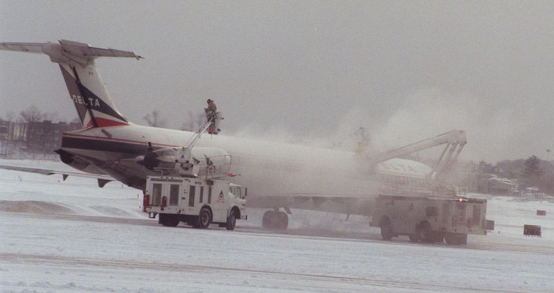 A Delta MD-80 aircraft is de-iced before cleared for flight at Laguardia Airport in New York, Saturday February 3, 1996