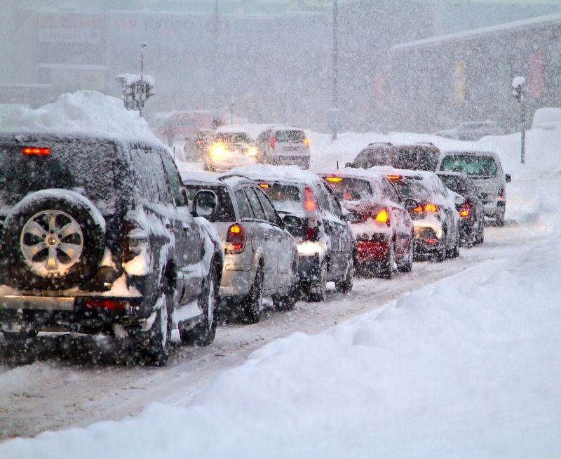 cars on road during a blizzard