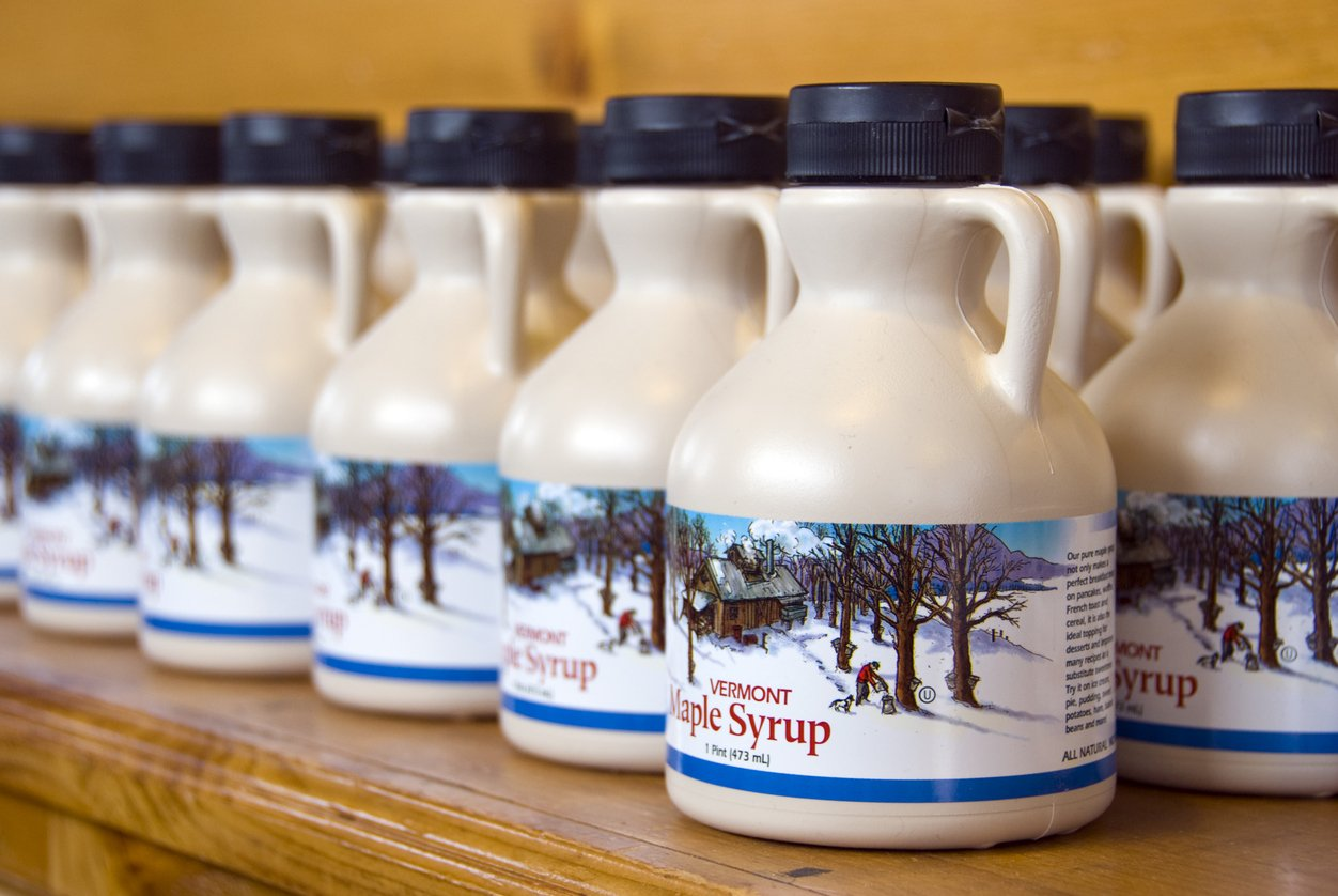 Rows of bottles of Vermont maple syrup