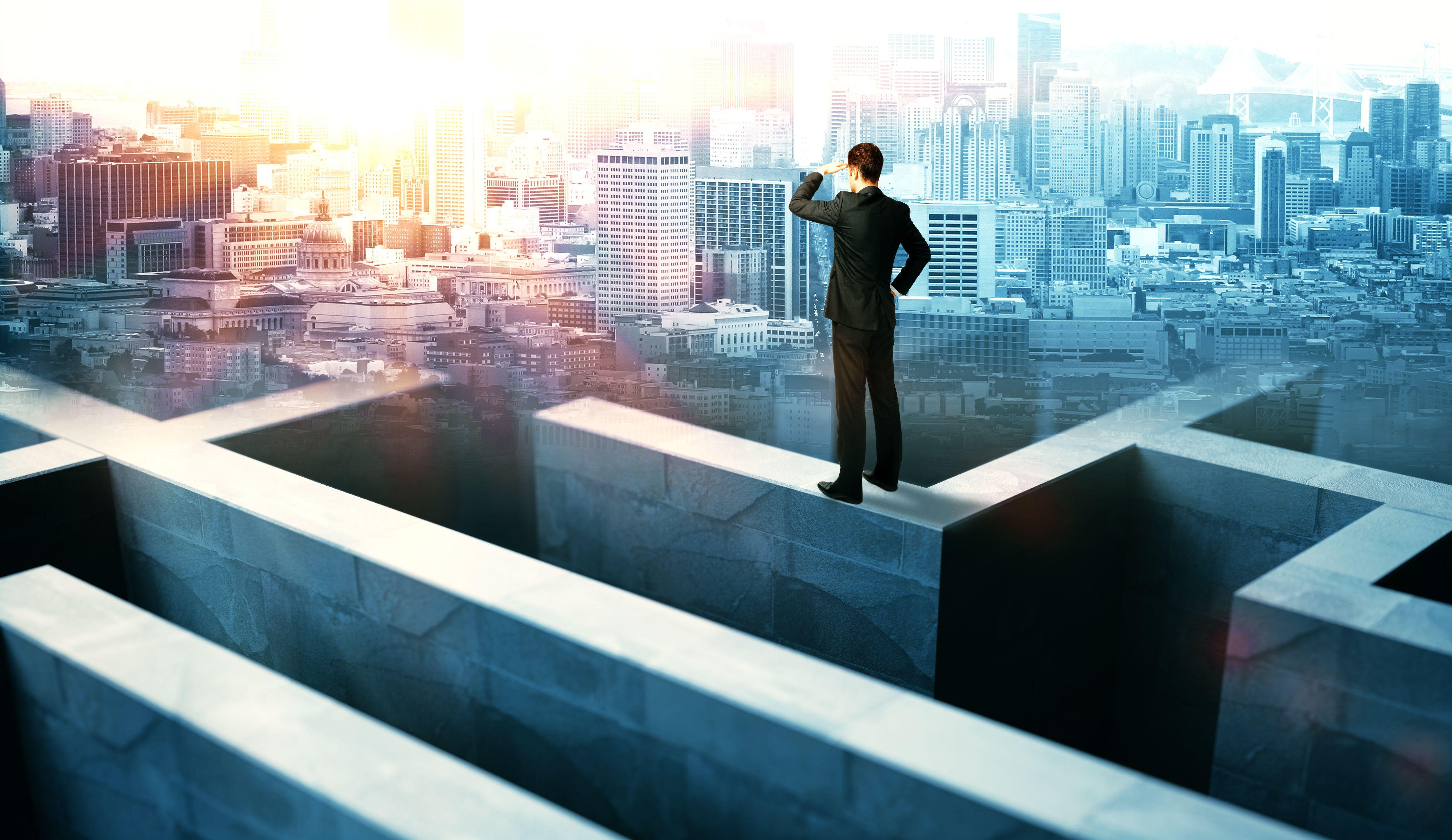 businessman on maze wall