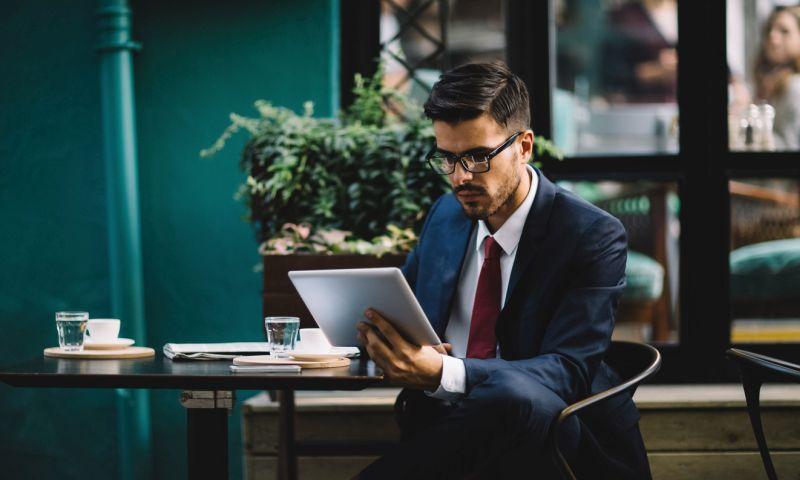 businessman scrutinizing insurance underwriting