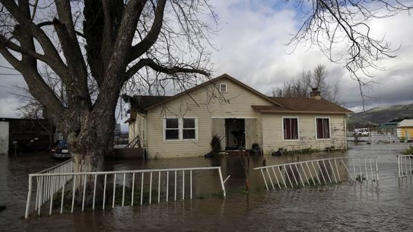 A flooded home is seen along Lovers Lane, Wednesday, Jan. 11, 2017, in Hollister, Calif. (AP Photo/Marcio Jose Sanchez)