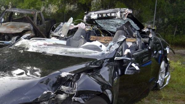 This file photo provided by the NTSB via the Florida Highway Patrol shows the Tesla Model S that was being driven by Joshua Brown, who was killed when the Tesla sedan crashed while in self-driving mode on May 7, 2016. (NTSB via Florida Highway Patrol via AP, File)