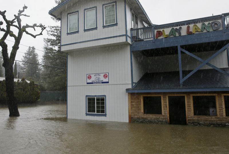 Flooding surrounds an arcade and miniature golf course