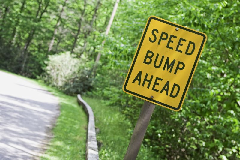 Speed bump ahead road sign