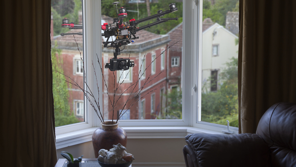 Drone hovering outside living room window