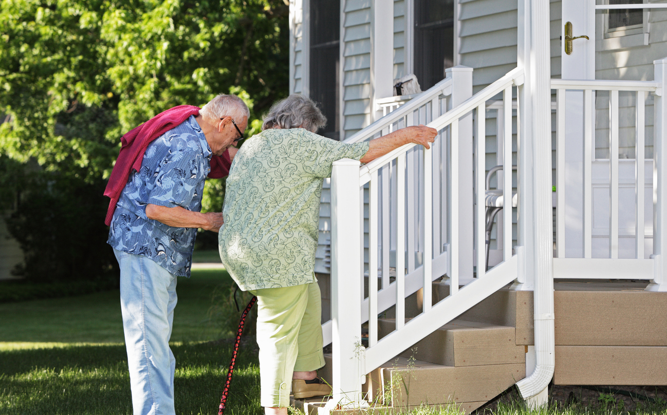 elderly couple going up the stairs