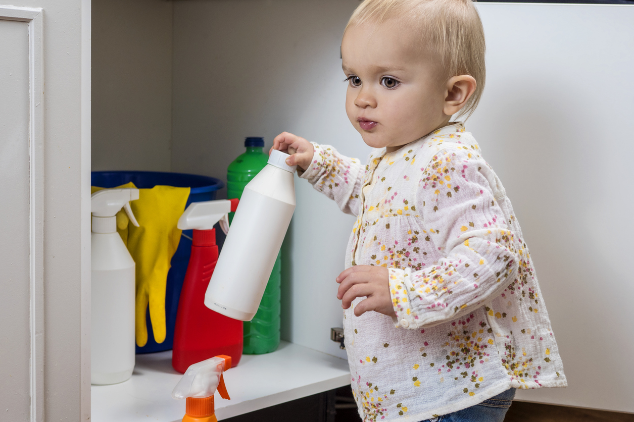 Child getting into chemicals in a cabinet