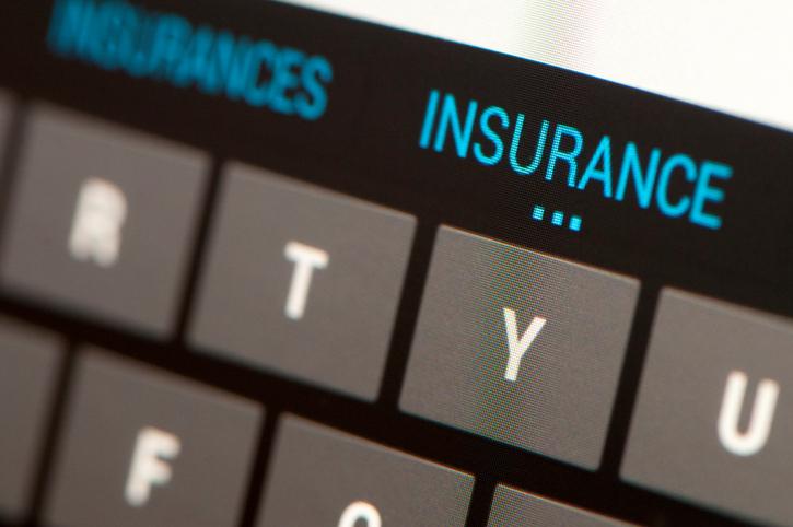 Cyber insurance words on computer keyboard