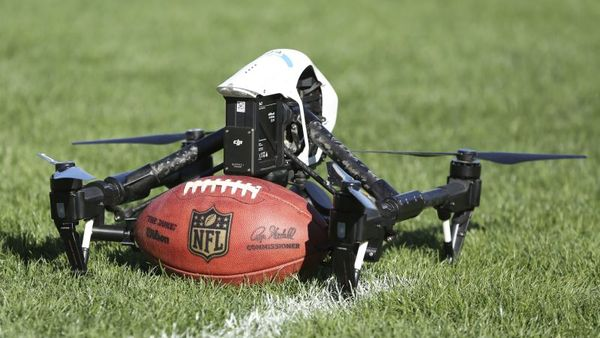 A drone prepares to go airborne with a football for the Drone Drop event at the 2017 Pro Bowl Skills Challenge on Wednesday, Jan. 25, 2017, in Lake Buena Vista, Fla. (AP Photo/Gregory Payan)