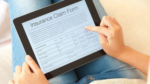 Insurance claim form on tablet