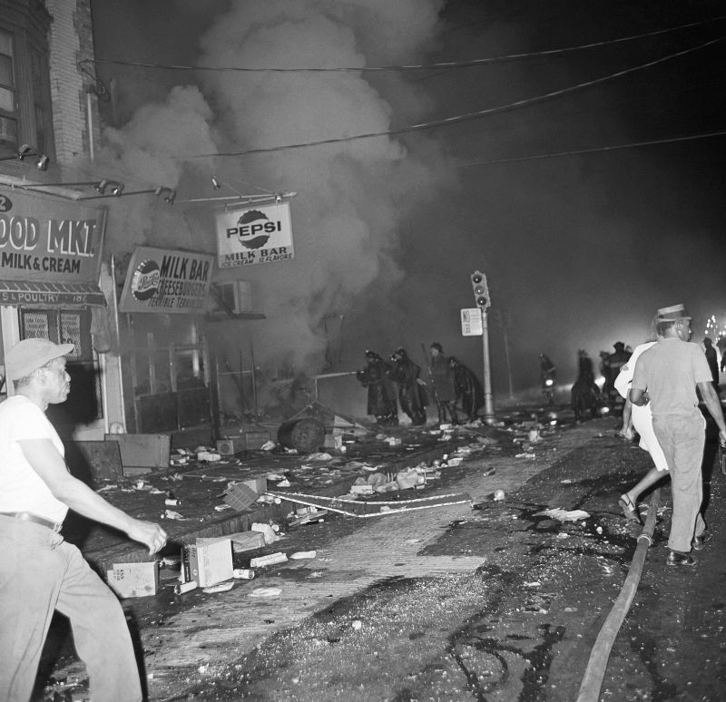 Newark firemen try to save burning structures early July 14, 1967 in Newark. N.J. after rioting erupted