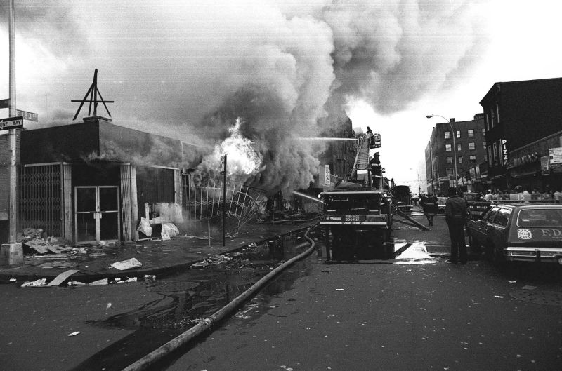 Firefighters in the Bronx battle flames in one of the many fires raging in stores throughout New York City during the blackout of 1977