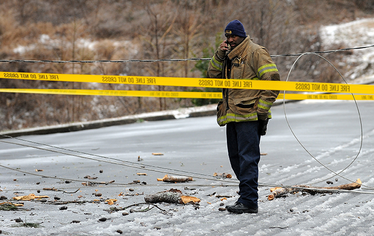 Downed power lines Atlanta police officer on cell phone