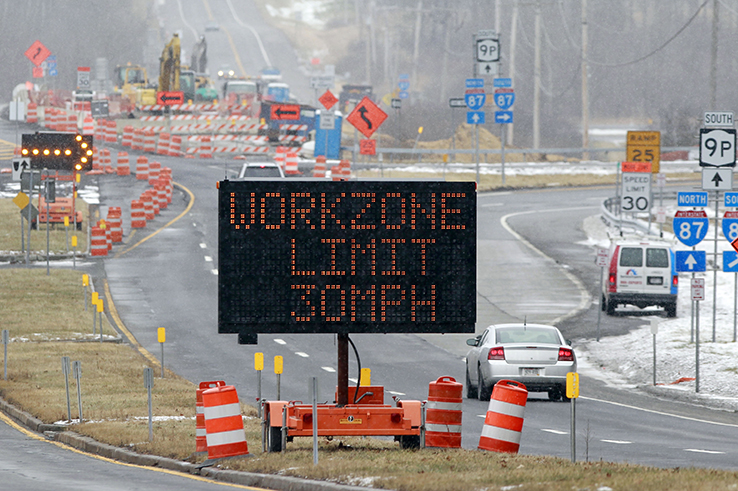 Highway construction work zone with snow