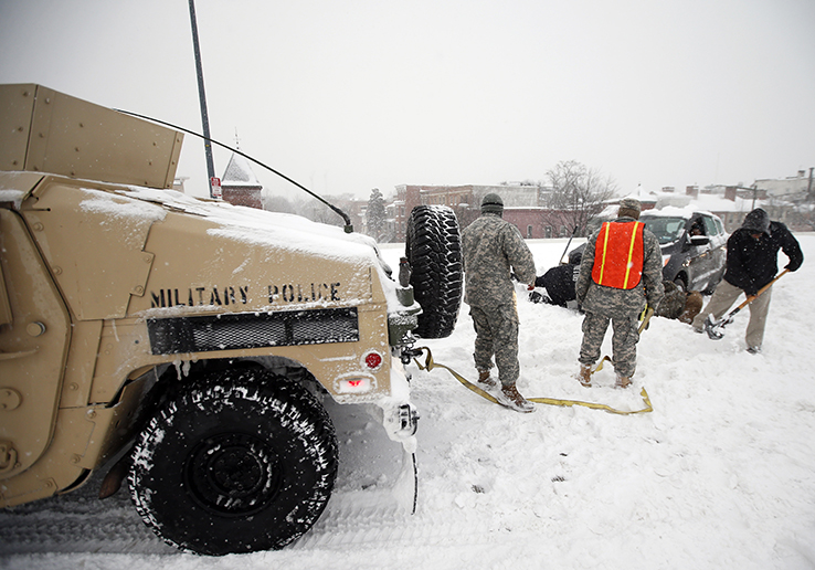 Soldiers help stranded motorist in snow storm