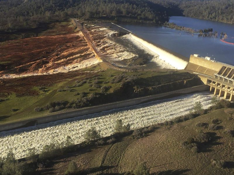 The main spillway, bottom, and an auxiliary spillway, upper, of the Oroville Dam at Lake Oroville in Oroville, Calif.