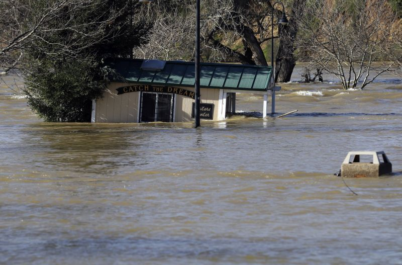 A building is submerged from the overflowing Feather River downstream from a damaged dam