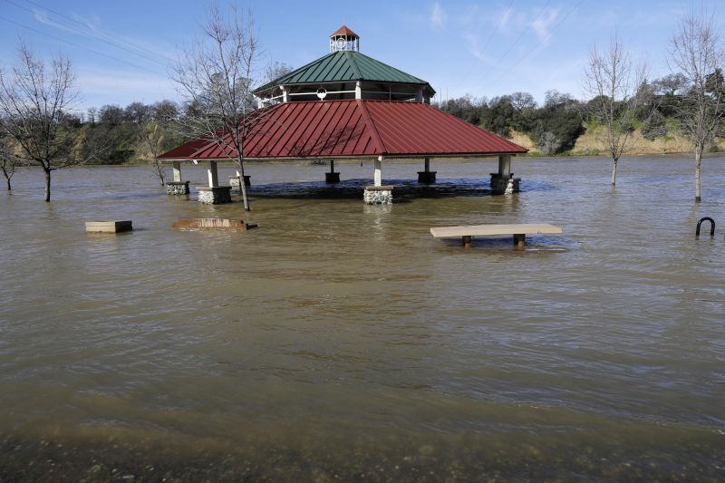 A gazebo is submerged from the overflowing Feather River