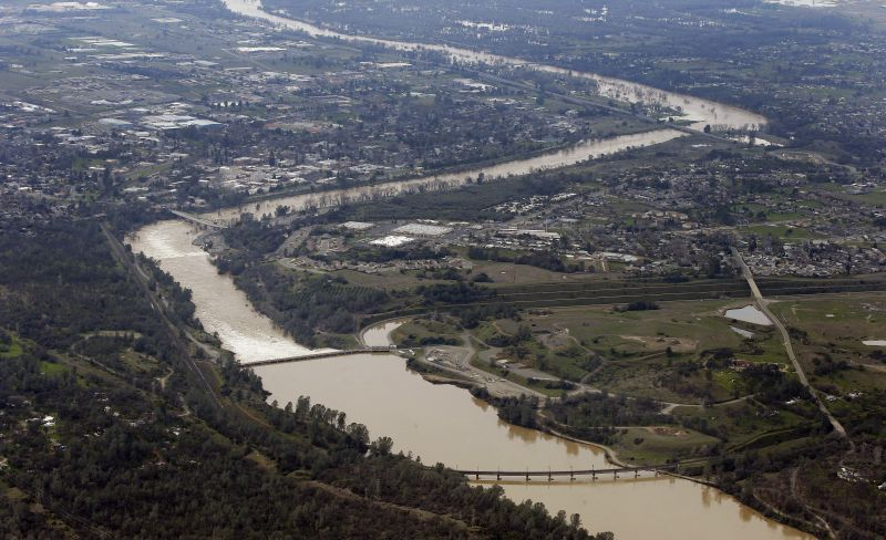 The water from the Feather River flows through Oroville, Calif., Monday, Feb. 13, 2017