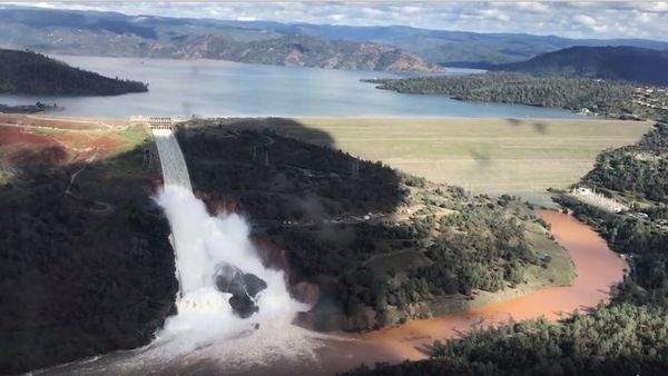 his Friday, Feb. 10, 2017 image from video provided by the office of Assemblyman Brian Dahle shows water flowing over an emergency spillway of the Oroville Dam in Oroville, Calif., during a helicopter tour by the Butte County Sheriff's office. About 150 miles northeast of San Francisco, Lake Oroville is one of California's largest man-made lakes, and the 770-foot-tall Oroville Dam is the nation's tallest. (Josh F.W. Cook/Office of Assemblyman Brian Dahle via AP)
