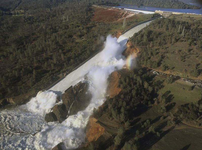 damaged spillway with eroded hillside in Oroville, Calif.