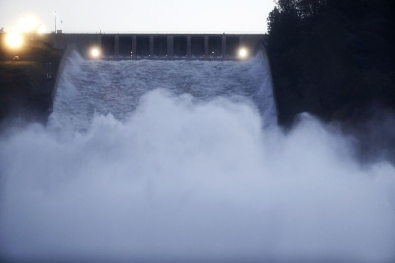 Water gushes from the Oroville Dam's main spillway