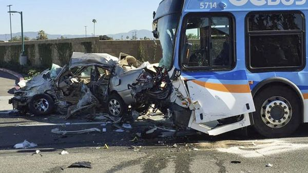 The aftermath of a crash between a car and an Orange County Transit Authority bus that killed the car's driver and sent bus passengers to the hospital in Anaheim, Calif., Tuesday, Dec. 27, 2016. (Anaheim Police Department via AP)