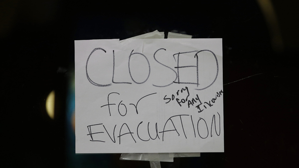 A closed sign is displayed on the door of Papacito's restaurant due to an evacuation order Feb. 12, 2017, in Marysville, Calif. Thousands of Northern California residents were under evacuation orders after authorities warned an emergency spillway in the country's tallest Oroville Dam was in danger of failing and unleashing uncontrolled flood waters on towns below. (AP Photo/Rich Pedroncelli))