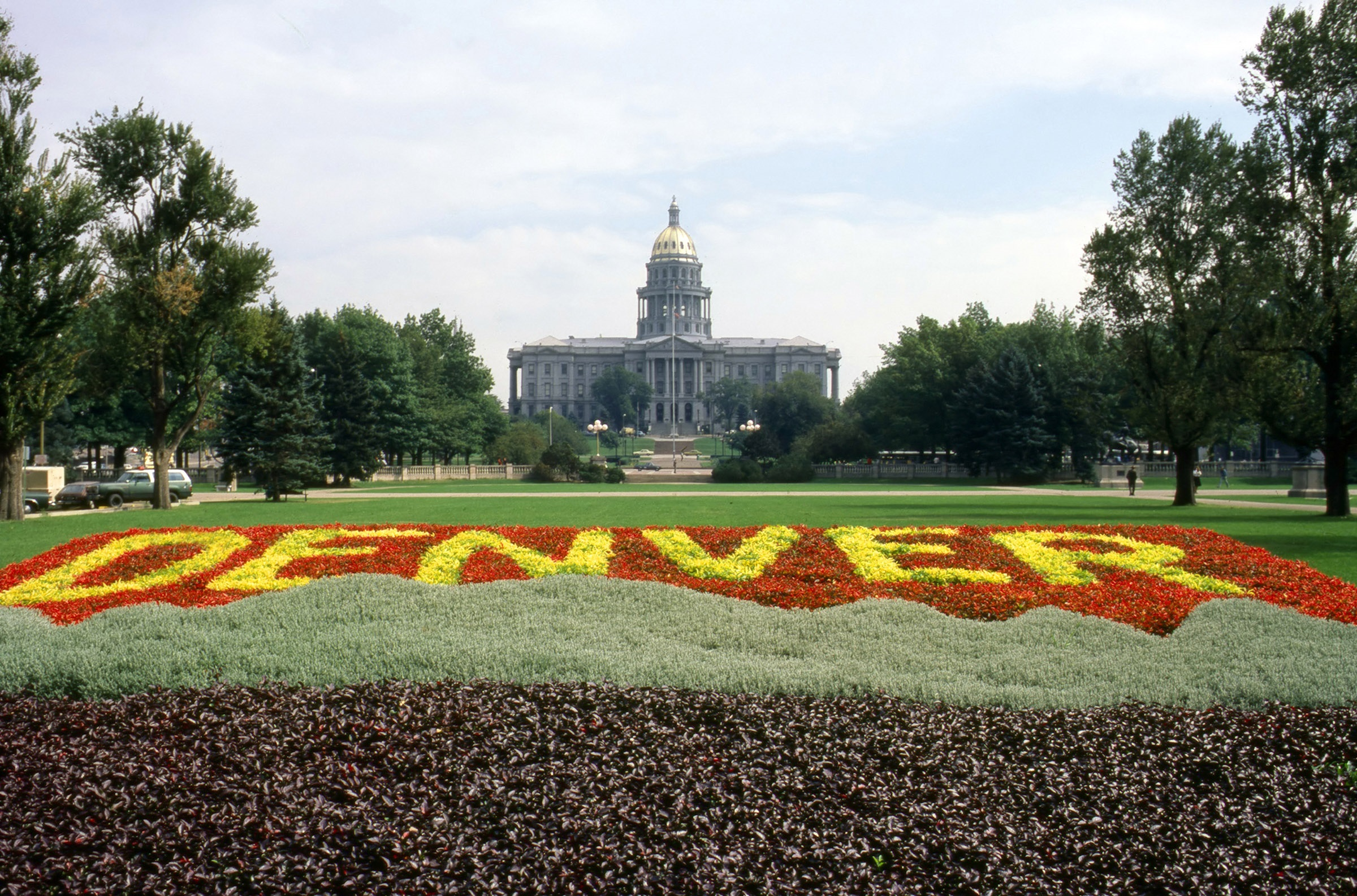 A colorful field of flowers in front of the State Capitol.